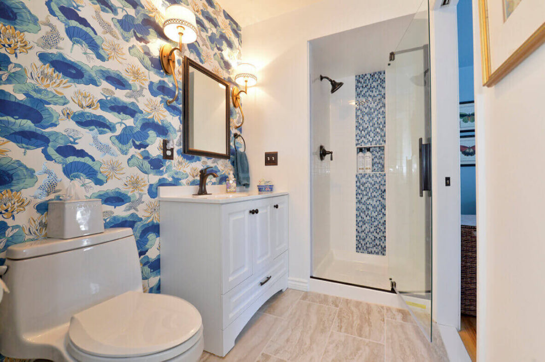 Compact guest bathroom with full shower and white vanity