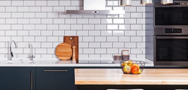 Mid-range Kitchen Remodel with white subway tile, navy cupboards, and a butcher block island