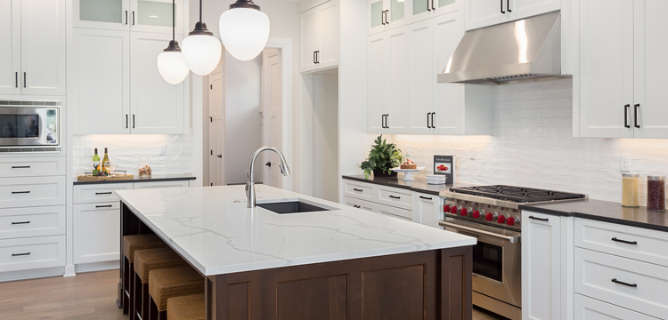 upscale kitchen remodeling with large eat-in kitchen island, white cabinetry, and stainless steel appliances