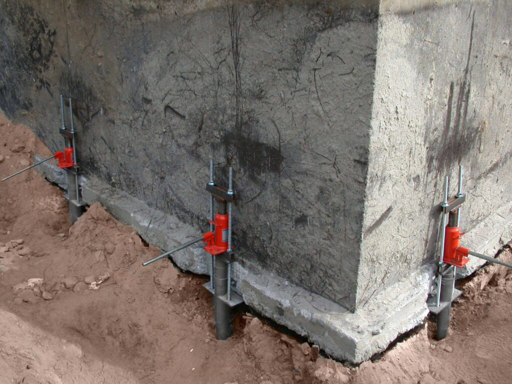 PierTech Helical Pile in action to stabilize a shifting foundation